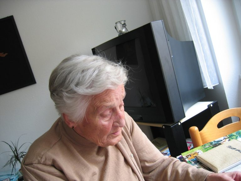 old woman in a hospice