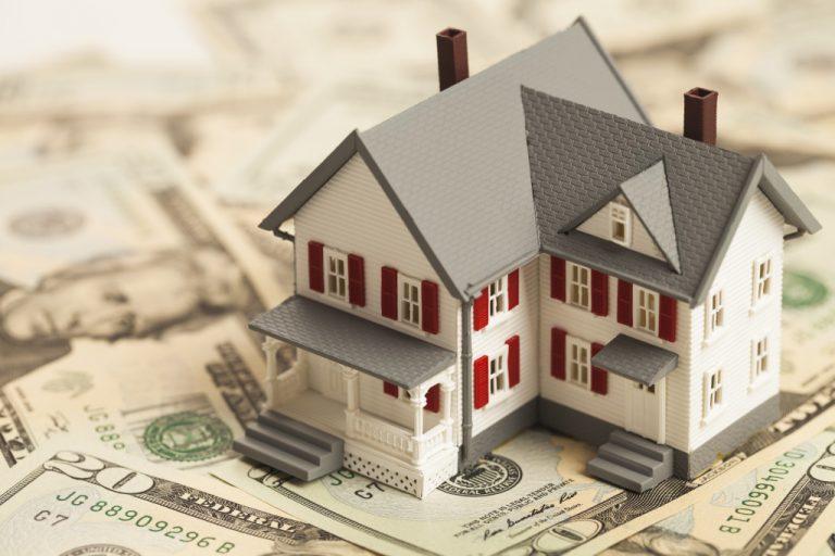 model house on paper bills