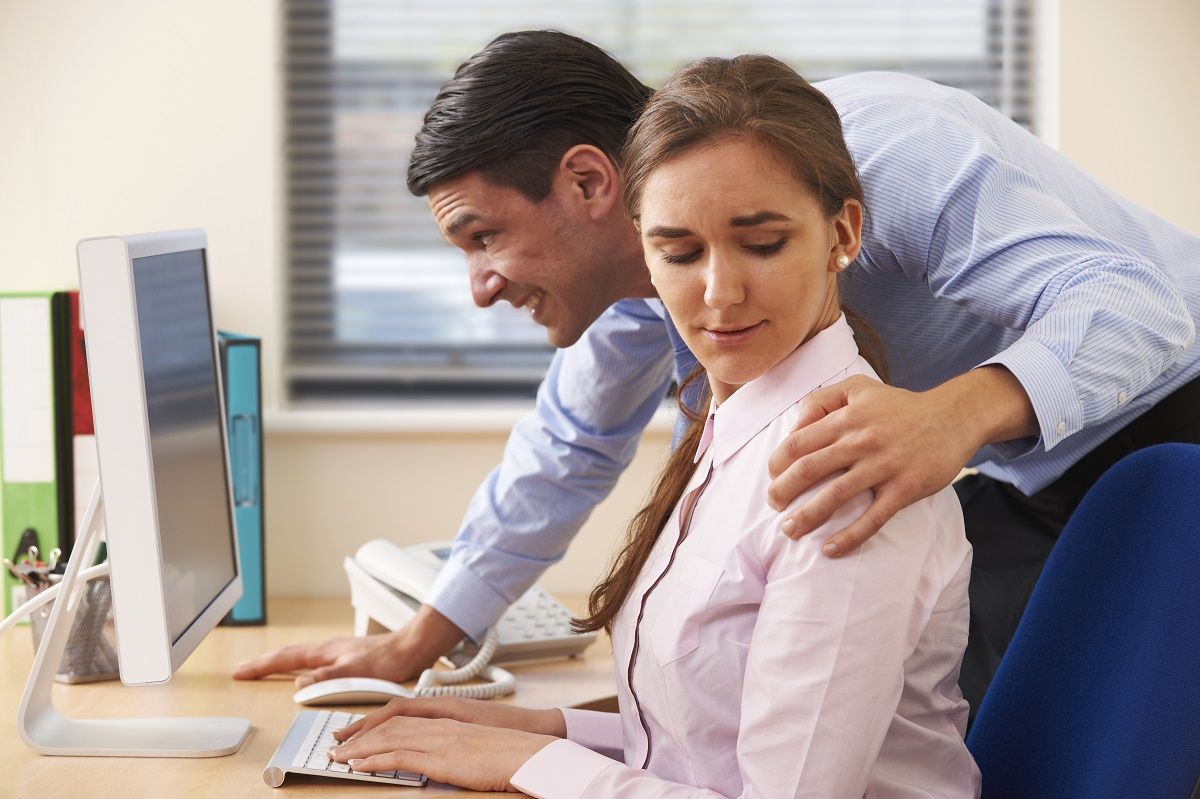 man harassing workmate